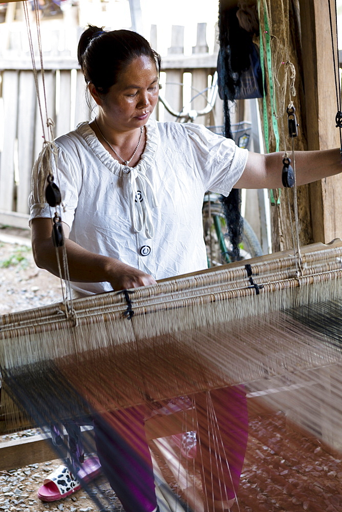 Tai Lue tribal woman using a traditional loom, Chiang Mai, Thailand, Southeast Asia, Asia
