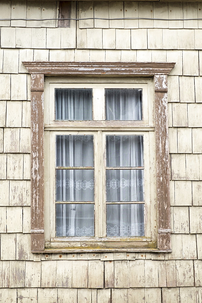 Distinctive wooden tiles around a window in Chiloe Island, Northern Patagonia, Chile, South America