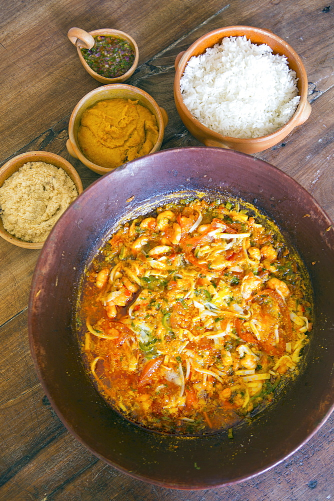 Seafood moqueca, a traditional Bahian dish, served with vatapa, rice and manioc farofa, Bahia, Brazil, South America