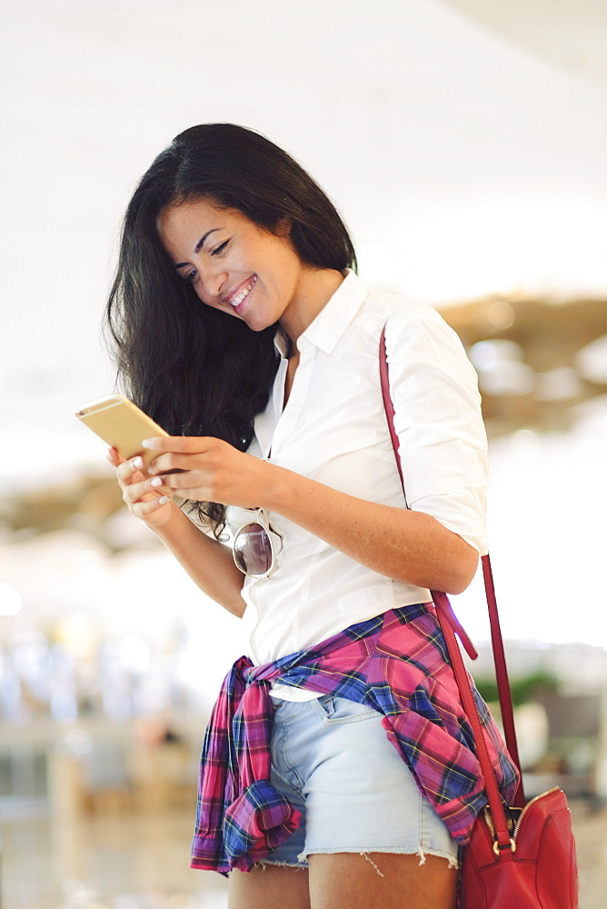 Young Brazilian woman using her mobile phone in central  Rio de Janeiro, Brazil, South America - 1176-737