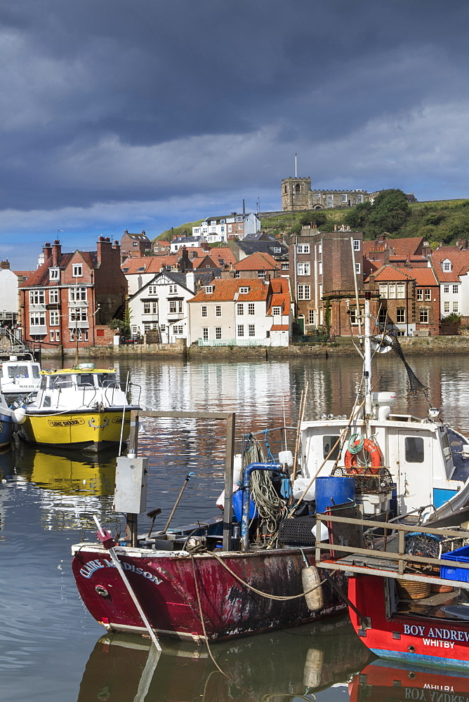 View of fishing boats in the harbour and the town centre, Whitby, Yorkshire, England, United Kingdom, Europe - 1176-808