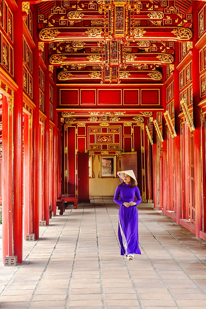 A woman in a traditional Ao Dai dress and Non La conical hat in the Forbidden Purple City of Hue, UNESCO World Heritage Site, Thua Thien Hue, Vietnam, Indochina, Southeast Asia, Asia - 1176-823
