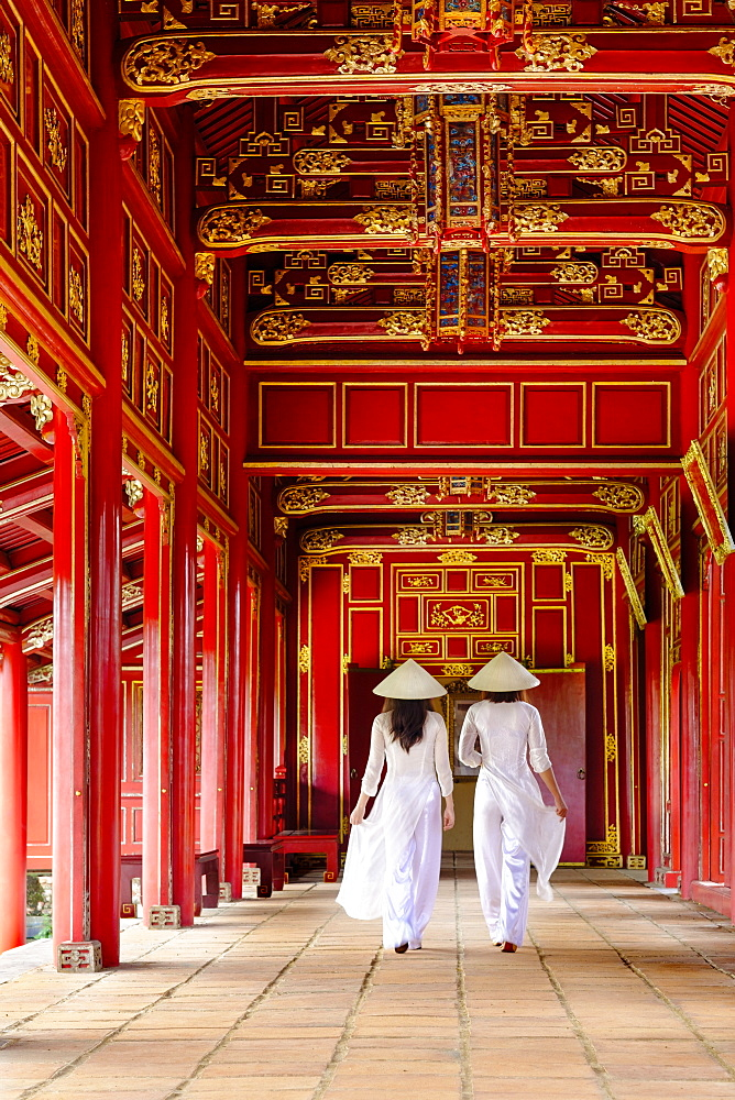 Two women in traditional Ao Dai dress and Non La conical hats in the Forbidden Purple City of Hue, UNESCO World Heritage Site, Thua Thien Hue, Vietnam, Indochina, Southeast Asia, Asia - 1176-826