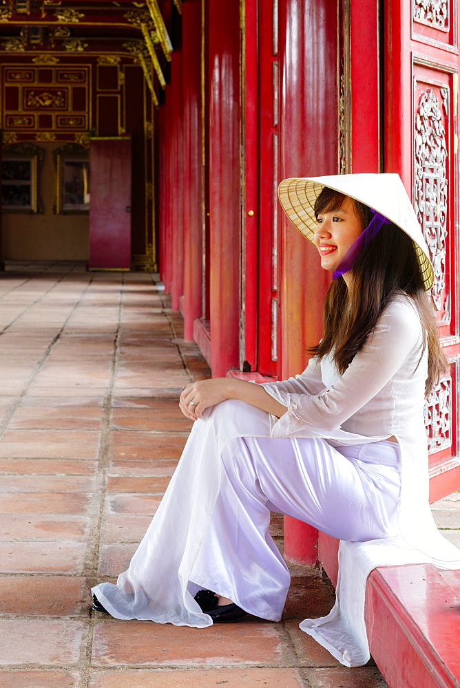 A woman in a traditional Ao Dai dress and Non La conical hat in the Forbidden Purple City of Hue, UNESCO World Heritage Site, Thua Thien Hue, Vietnam, Indochina, Southeast Asia, Asia - 1176-827