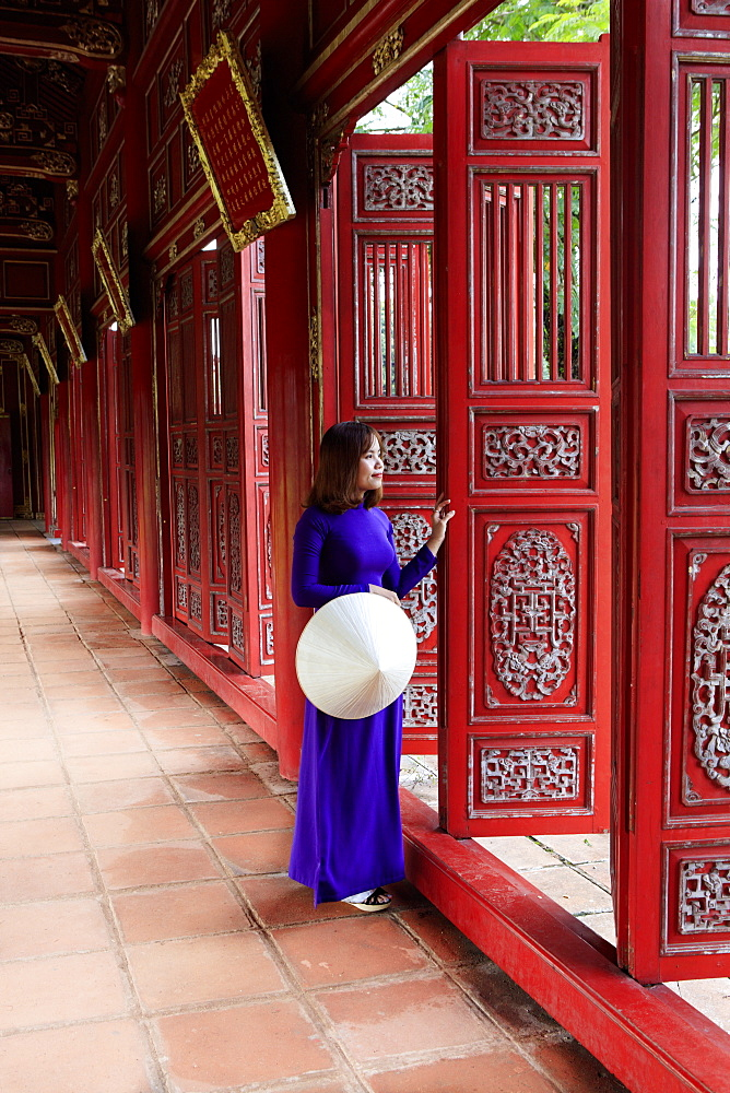 A woman in a traditional Ao Dai dress and Non La conical hat in the Forbidden Purple City of Hue, UNESCO World Heritage Site, Thua Thien Hue, Vietnam, Indochina, Southeast Asia, Asia - 1176-833