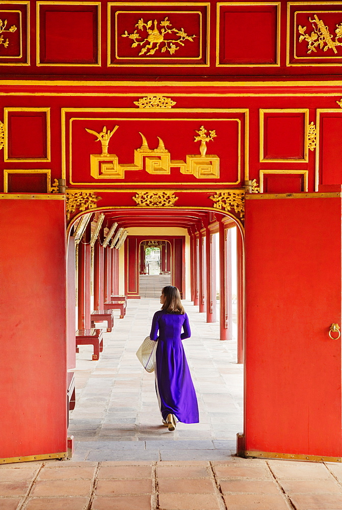 A woman in a traditional Ao Dai dress in the Forbidden Purple City of Hue, UNESCO World Heritage Site, Thua Thien Hue, Vietnam, Indochina, Southeast Asia, Asia