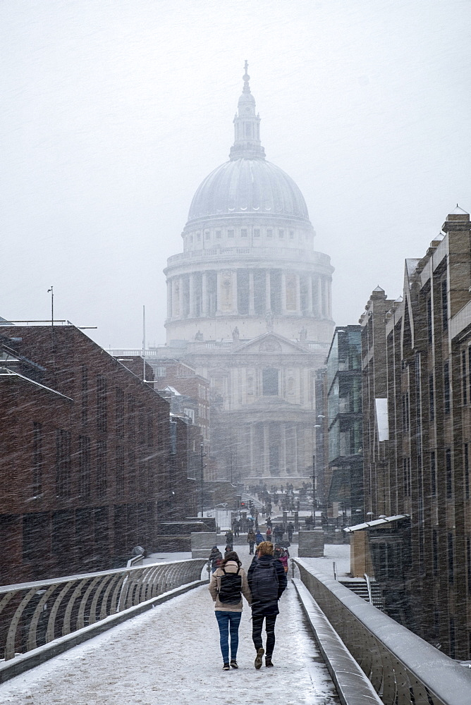 View of St. Paul's Cathedral and the Millennium Bridge in snow, London, England, United Kingdom, Europe - 1176-896