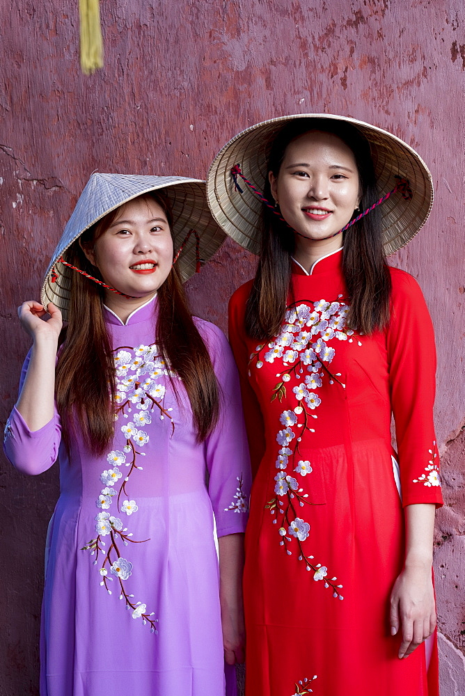 Young Vietnamese women wearing a traditional Ao Dai dress, Vietnam, Indochina, Southeast Asia, Asia