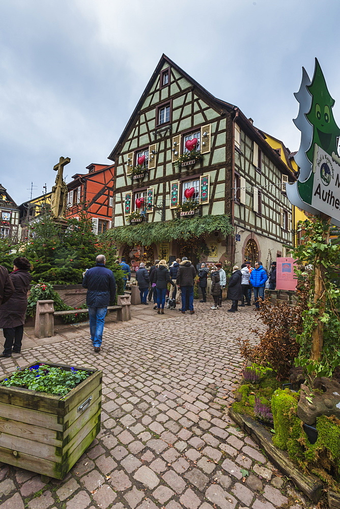 A typical house in the medieval old town decorated with Christmas ornaments, Kaysersberg, Haut-Rhin department, Alsace, France, Europe
