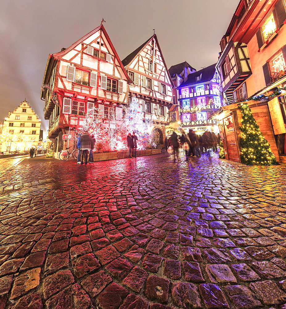 Panorama of typical houses enriched by Christmas ornaments and lights at dusk, Colmar, Haut-Rhin department, Alsace, France, Europe