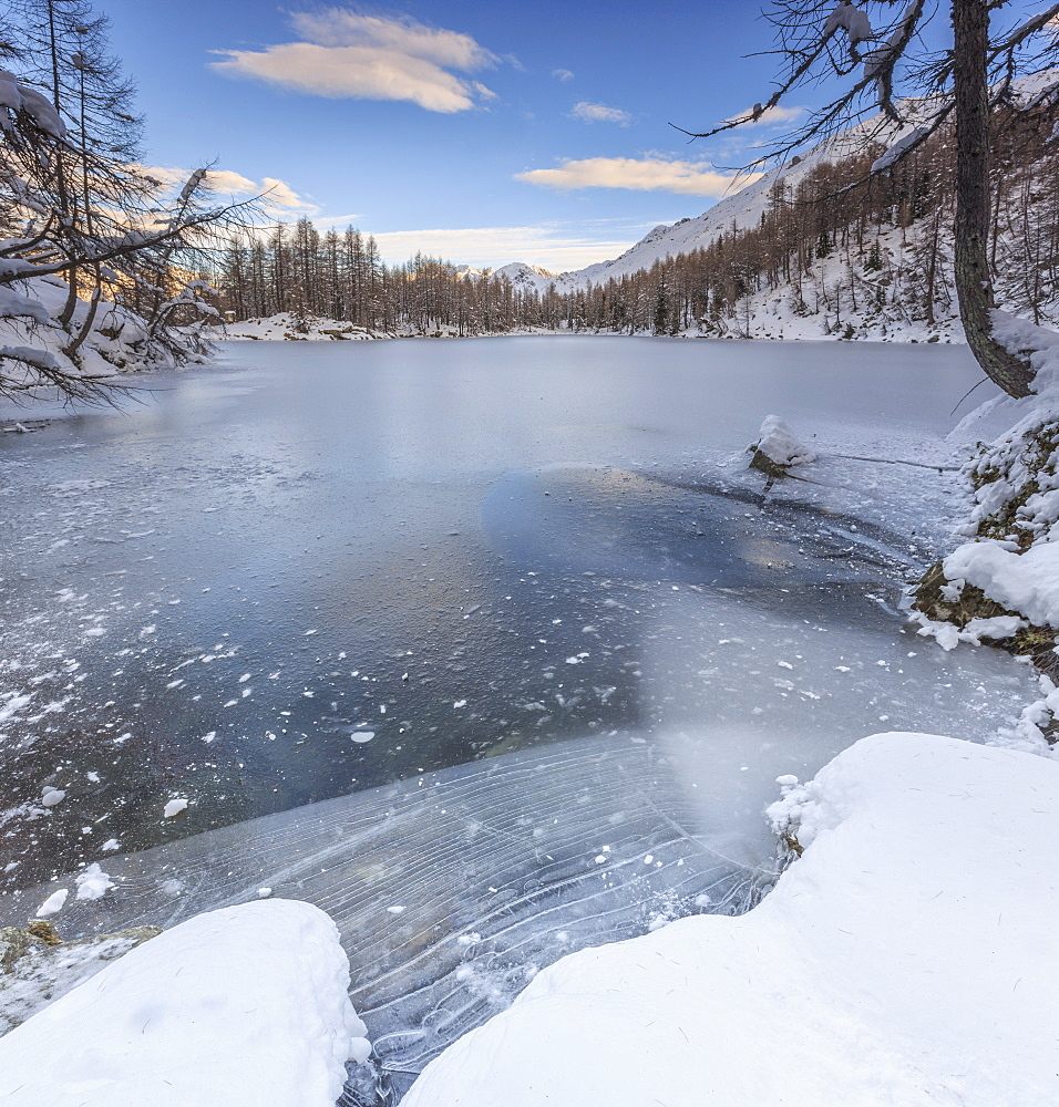 Panorama of frozen Lago Azzurro at dawn, Spluga Valley, Province of Sondrio, Valtellina, Lombardy, Italy, Europe