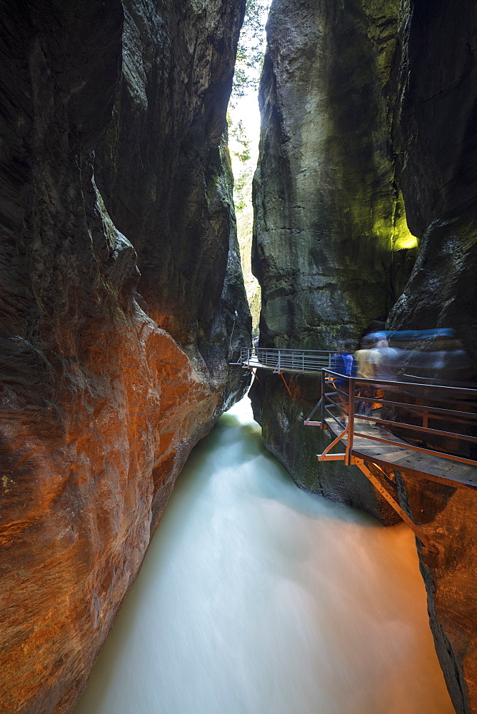 Water of creek flows in the narrow limestone gorge carved by river, Aare Gorge, Bernese Oberland, Canton of Berne, Switzerland, Europe