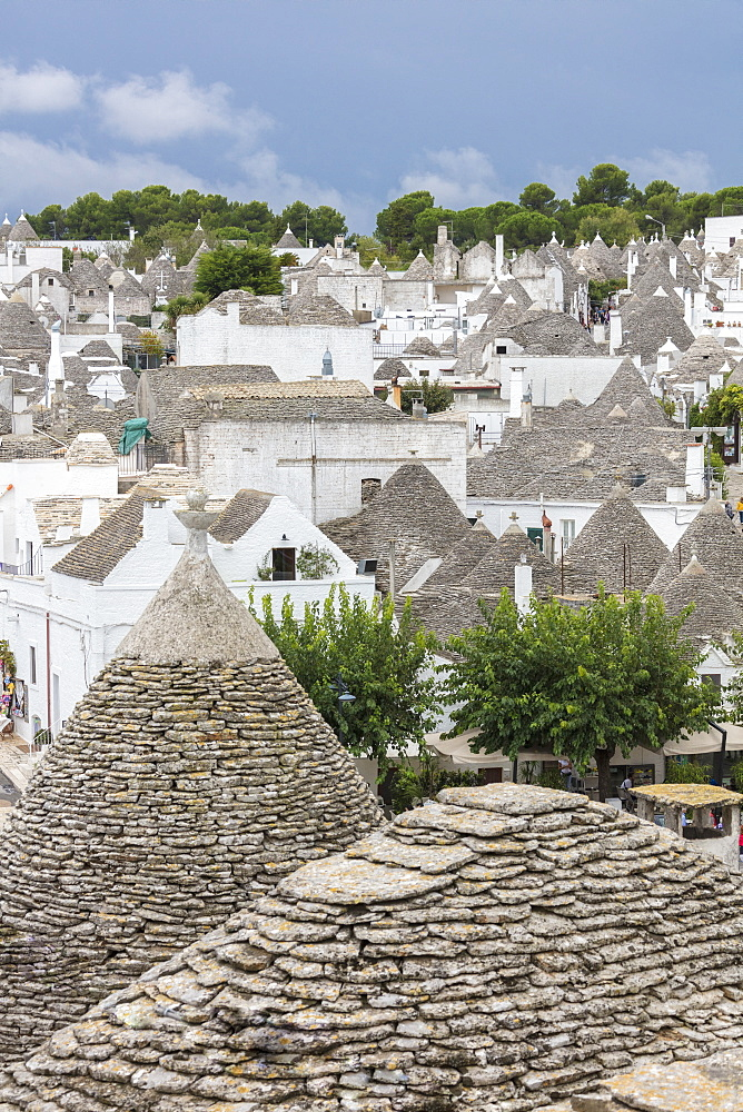 View of the typical Trulli built with dry stone with a conical roof Alberobello province of Bari Apulia Italy Europe