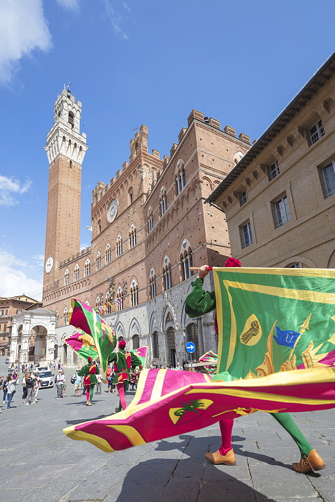 Typical exhibition of traditional clothes and flags of the different contradas Piazza del Campo Siena Tuscany Italy Europe - 1179-1935