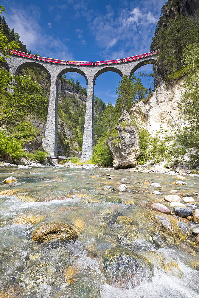 Alpine stream below the Bernina Express train on Landwasser Viadukt, Filisur, Albula Valley, Canton of Graubunden, Switzerland, Europe