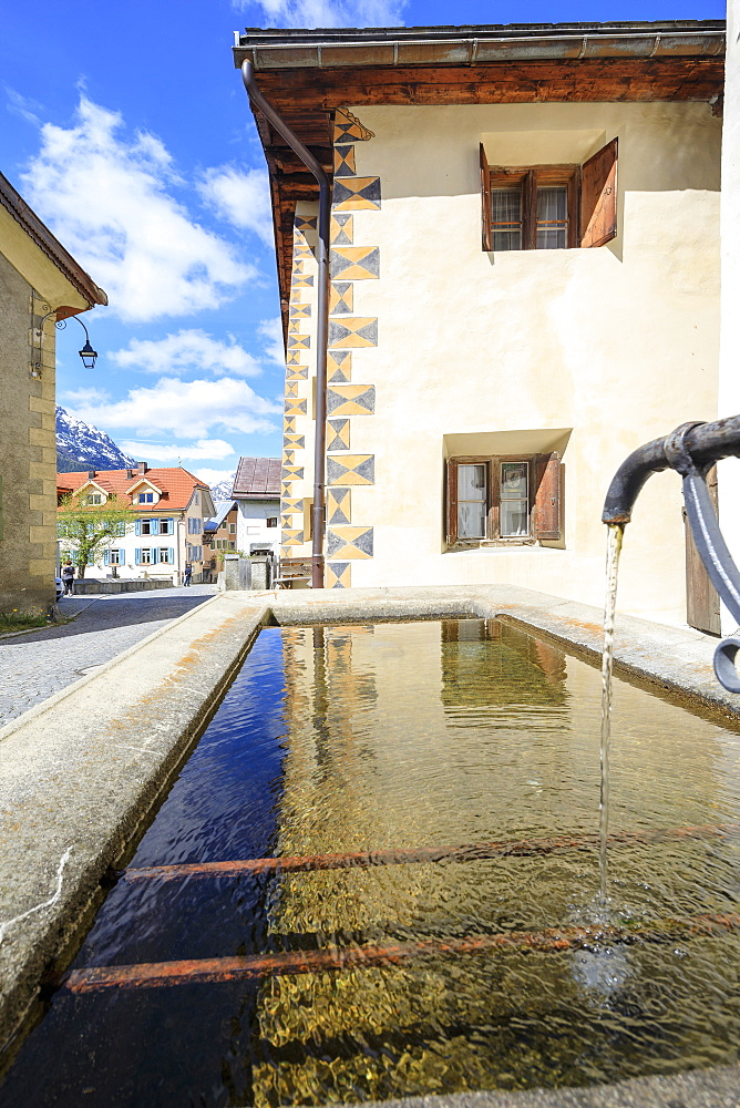 Fountain in the alleys of the alpine village, Guarda, Inn District, Lower Engadine, Canton of Graudbunden, Switzerland, Europe