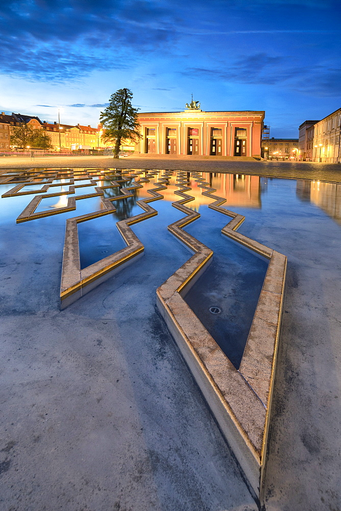 Thorvaldsens Museum reflected in the fountain of Bertel Thorvaldsen's Square at night, Copenhagen, Denmark, Europe