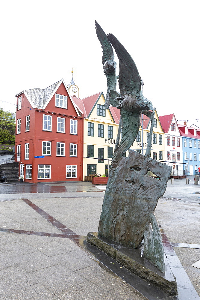Statue and typical houses in the city centre of Torshavn, Streymoy Island, Faroe Islands