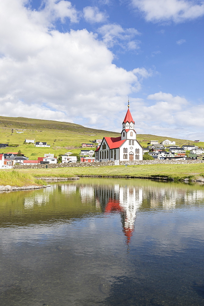 Church of Sandavagur reflected in water, Vagar Island, Faroe Islands