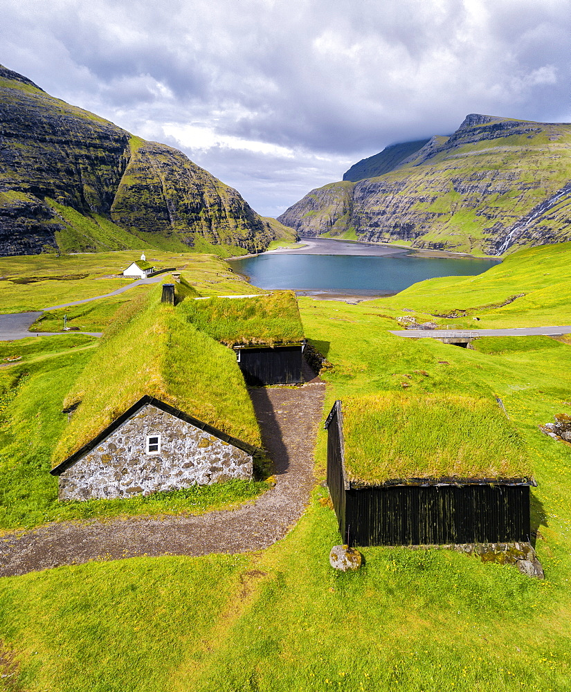 Elevated view of typical grass roof (turf roof) houses, Saksun, Streymoy Island, Faroe Islands, Denmark, Europe (Drone) - 1179-2801