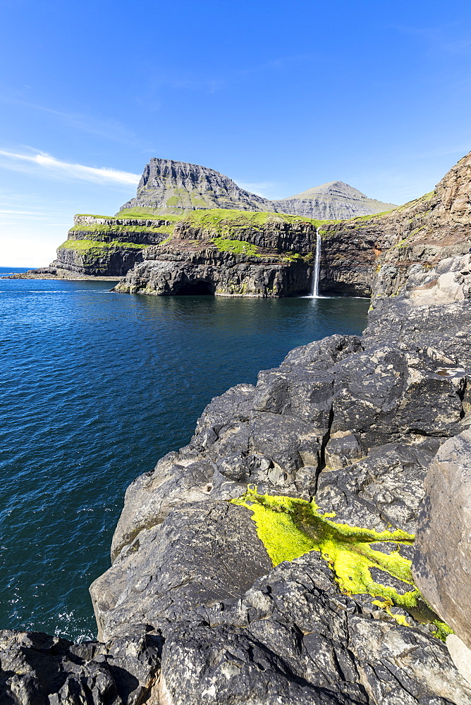 Cliffs around Mulafossur Waterfall in summer, Gasadalur, Vagar Island, Faroe Islands