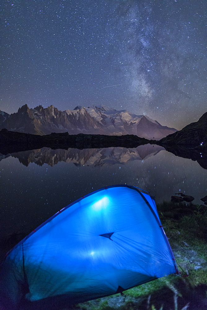 Camping with a tent under the Milky Way at Lac des Cheserys, looking at Mont Blanc, Haute Savoie, French Alps, France, Europe
