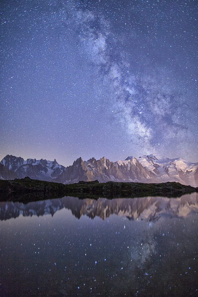 A sharp Milky Way on a starry night at Lac des Cheserys with Mont Blanc, Europe's highest peak, to the right, Haute Savoie, French Alps, France, Europe