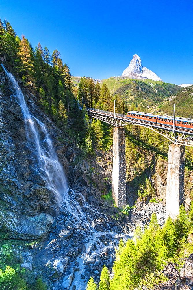Gornergrat Bahn train on viaduct with Matterhorn on background, Zermatt, canton of Valais, Switzerland