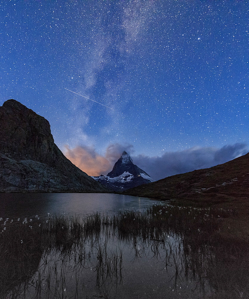 Stars and Milky Way above the Matterhorn reflected in Lake Stellisee, Zermatt, Canton of Valais, Swiss Alps, Switzerland, Europe