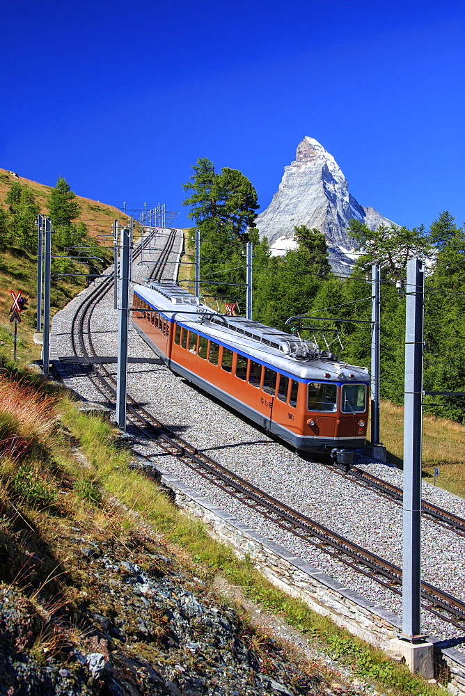 The swiss Bahn train runs on its route with the Matterhorn in the background, Gornergrat, Canton of Valais, Swiss Alps, Switzerland, Europe