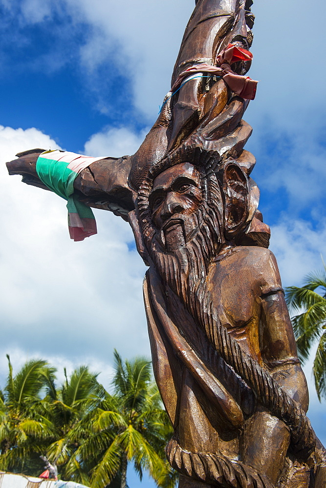 Wooden carvings on the Monument des Dix-Neuf (Monument of 19), Ouvea, Loyalty Islands, New Caledonia, Pacific