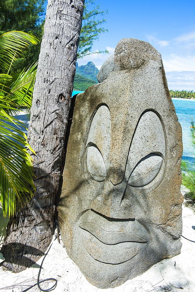 Carved stone statue on a Motu, Bora Bora, French Polynesia