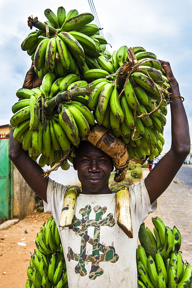 Man carrying lots of bananas on his head, Bujumbura, Burundi, Africa
