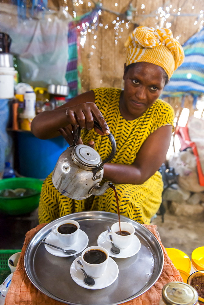 Woman serving Ethiopian coffee, Danakil depression, Ethiopia, Africa