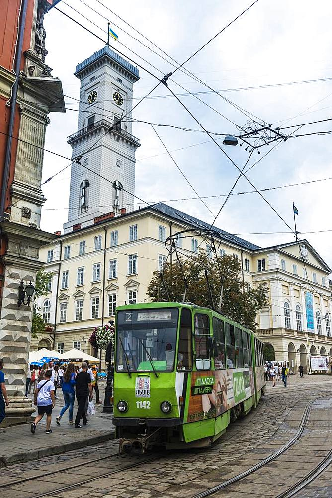 Tram in front of the Lviv City Council building, Lviv, UNESCO World Heritage Site, Ukraine, Europe