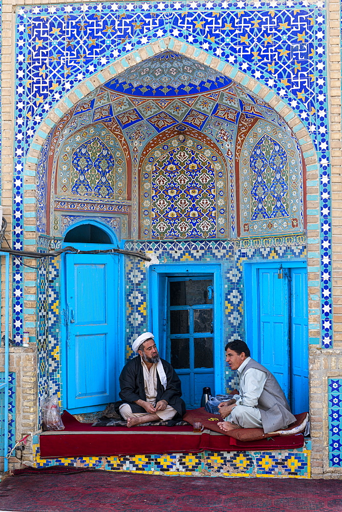 Men discussing in a corner of the Blue Mosque, Mazar-E-Sharif, Afghanistan, Asia
