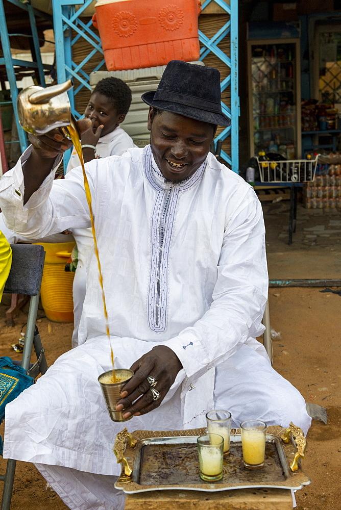 Man preparing tea, Unesco world heritage sight Agadez, Niger