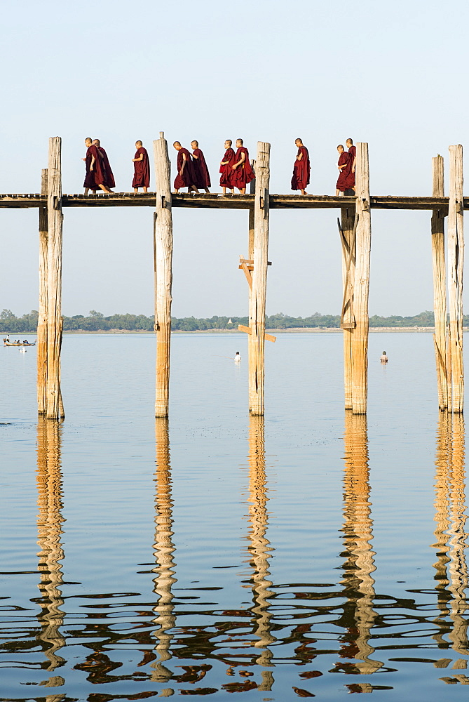 Monks crossing the U Bien bridge across Taungthaman Lake, Amarapura, Mandalay, Myanmar (Burma), Asia
