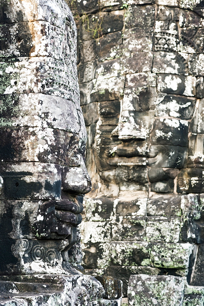 Giant heads at the Bayon temple, UNESCO World Heritage Site, Angkor, Siem Reap, Cambodia, Indochina, Southeast Asia, Asia - 1186-32