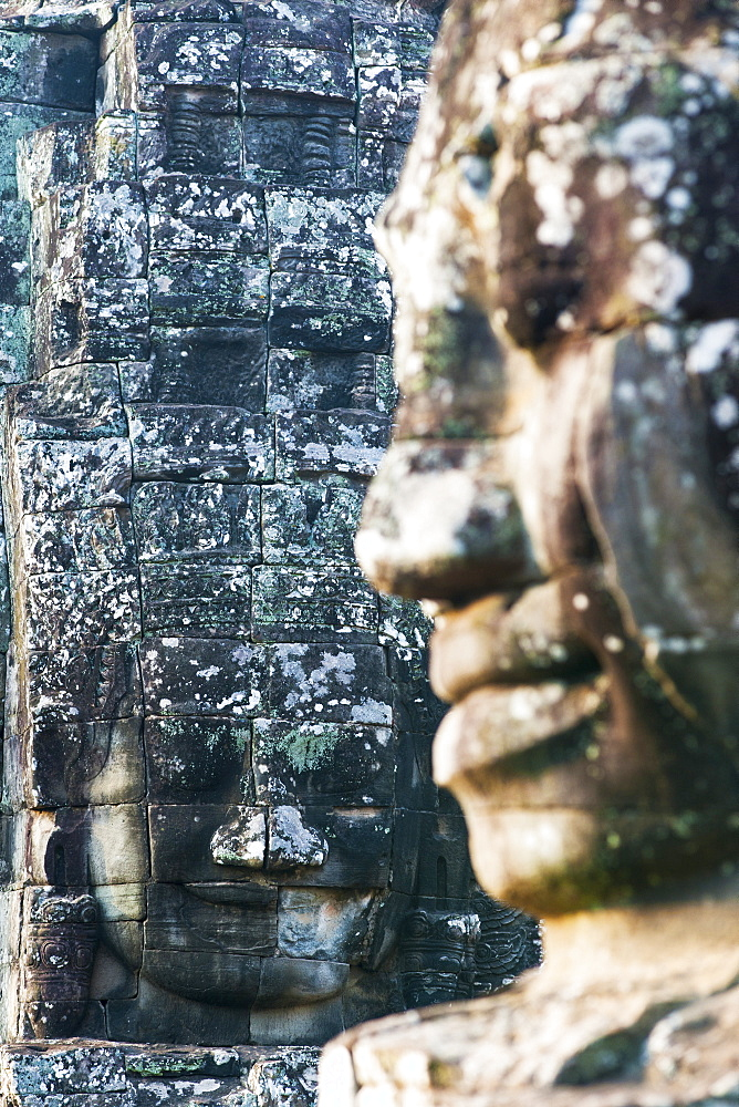 Giant heads at the Bayon temple, UNESCO World Heritage Site, Angkor, Siem Reap, Cambodia, Indochina, Southeast Asia, Asia