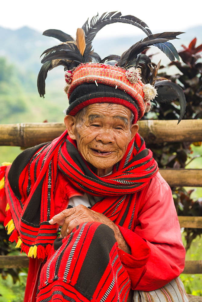 Portrait of an old person in traditional clothes and feathered hat, Banaue, Luzon, Philippines, Southeast Asia, Asia