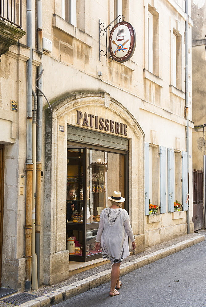 Woman walking through Martigues, Bouches du Rhone, Provence, Provence-Alpes-Cote d'Azur, France, Europe
