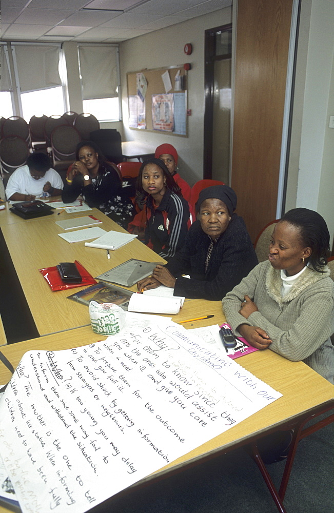 Coping centre for people living with aids/hiv, botswana. Of the 300,000 hiv-positive people in botswana only these 12 women have admitted their status & have formed above-named ngo