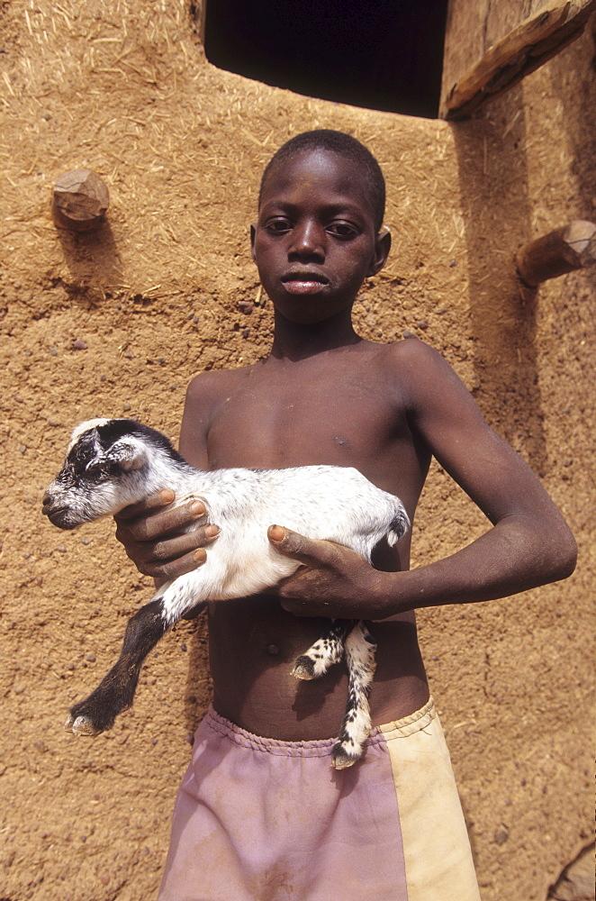 Boy with goat, burkina faso. Kalsaka village