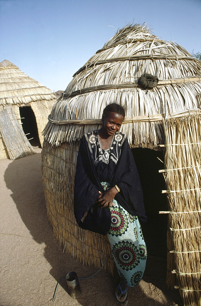 Homelife, niger (west africa). Tahoua village. Woman outside her home