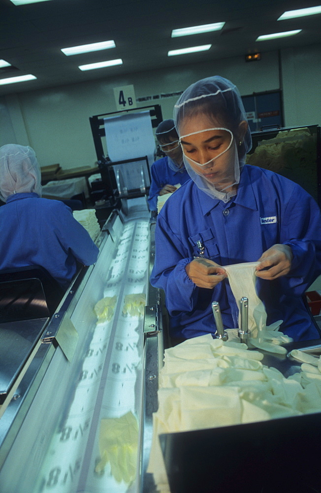 Surgical glove factory,malaysia. Penang. Tiger economy / women working