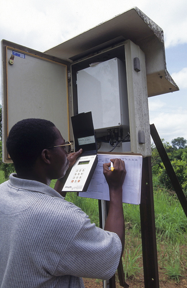 Onchoceriasis, ivory coast. Ngolodougou river. Satellite transmission station sending info about flow of river enabling correct dose of larvicide to be sprayed to kill blackfly larva