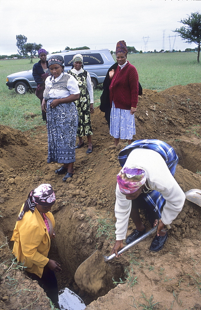 Burial of baby, botswana. Public cemetery, gaborone. About 85 people are infected with hiv every day and 1 in 8 infants is infected at birth