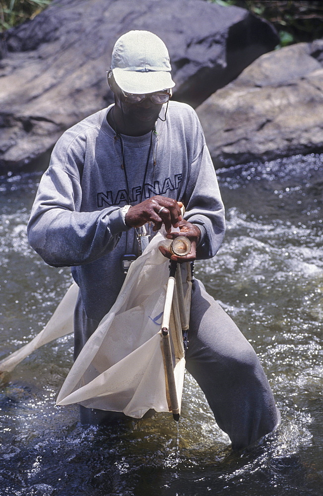 Onchoceriasis, ivory coast. River marahoue. Who river blindness programme, hydrological sampling to test environmental impact of spraying to eradicate black fly.