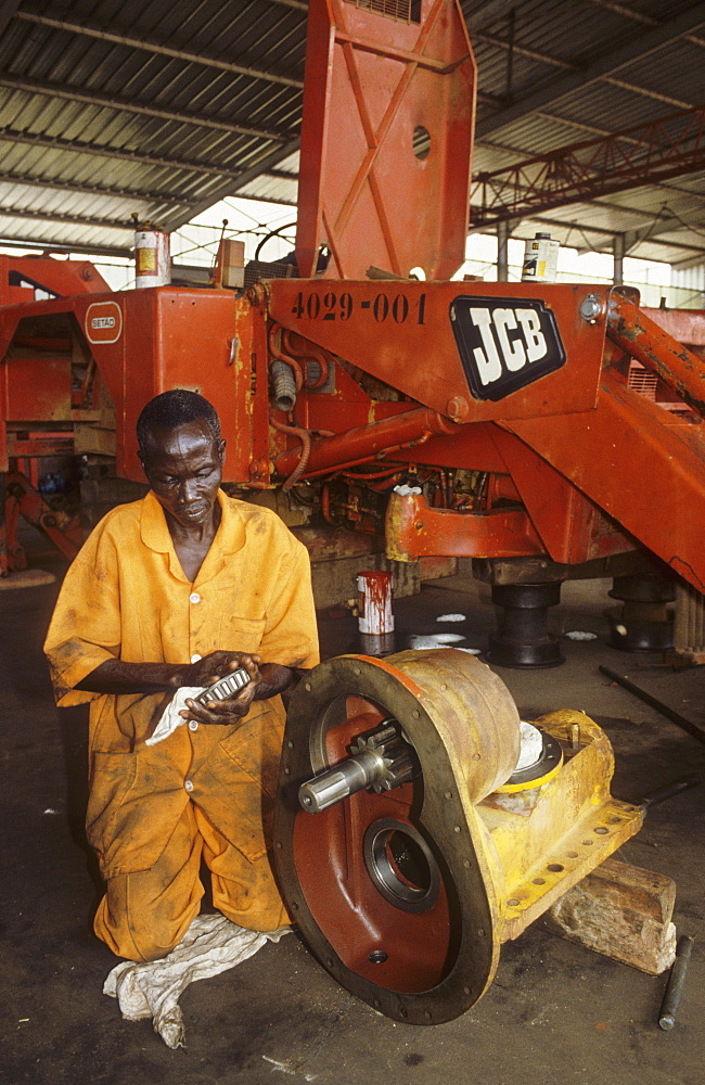 Engineer, cote d ivoire. Abidjan. Technician repairing engineering equipment